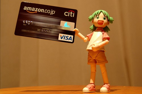Anime doll holding VISA card