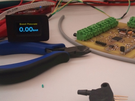 OLED display in a dashboard button