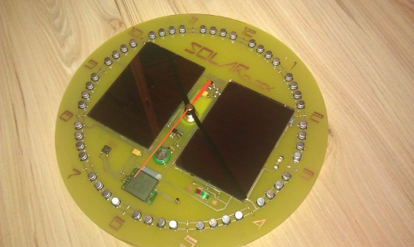 solar-clock-uses-storage-capacitors-and-batteries