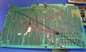 "Commodore C128 PCB Bottom showing jumpers and ""dead bug"" IC's."