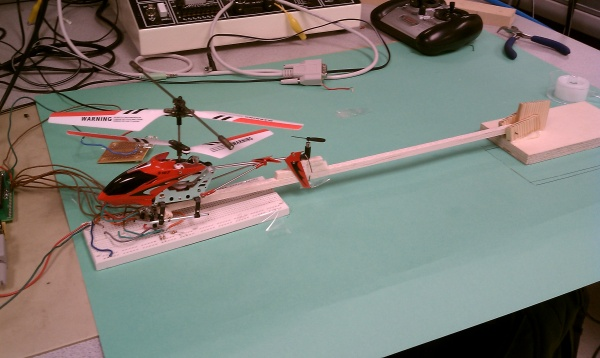 model helicopter attached to boom