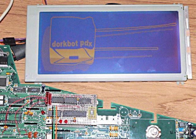 Dorkbot logo on a large LCD display