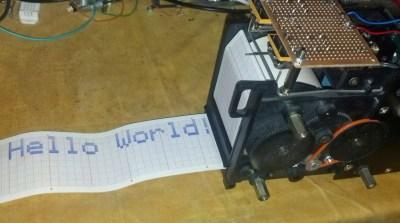 A chart recorder printing 'Hello World'