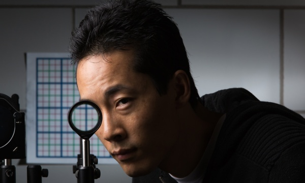 Invisibility cloaking with lenses