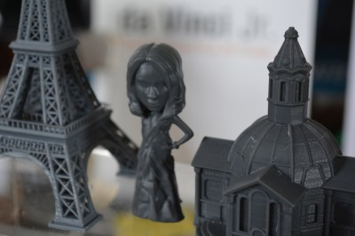 The Eiffel tower, an architectural model, and a Bratz doll, all printed on the XYZPrinting Nobel