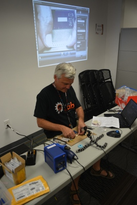 [Bob] demonstrating the scotch-tape trick under USB microscope