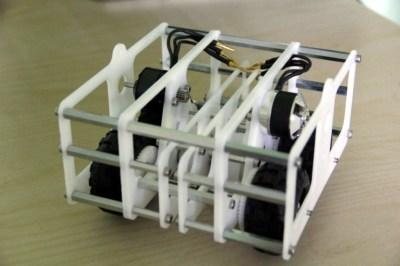 [Joshua Vasquez]'s laser cut POM robot.