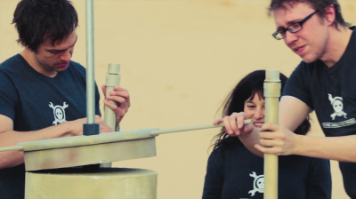 [Matt], [Sophi], and [Brian] building the Moisture Vaporator during the launch video