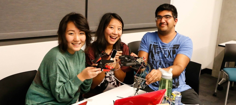 (Left to right) Erin Paeng, Cherie Ho, and Shaan Gareeb take first place by rewiring an rc helicopter for hand-control with a Leap Motion