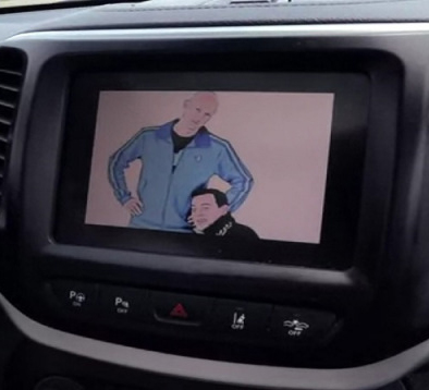 Charlie Miller and Chris Valasek displayed on the center console of a Jeep