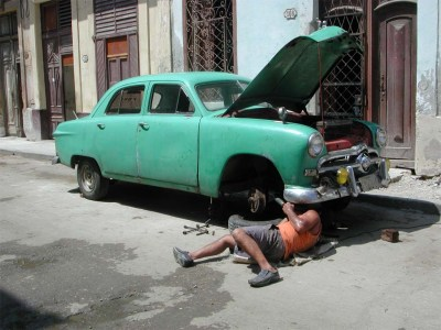 Roadside repairs are a fact of life. Image source: The Detroit Bureau