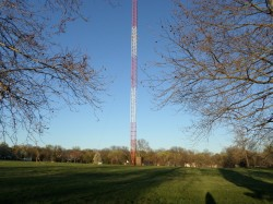 A guyed mast in the suburbs.