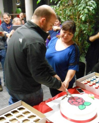 Eben and Liz Upton cutting the birthday cake