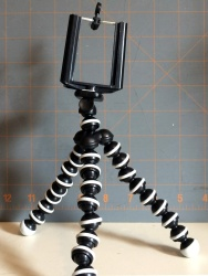 Three dollars well spent. The stand unscrews from the clamp and lets it be used with a standard camera mounting thread.