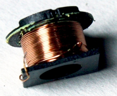 The transformer from a iPhone power supply. From TK