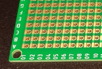 One side of a Perf+ 2 board. Each hole can selectively connect to bus next to it with a solder bridge. The bus strips are horizontal on the back side.