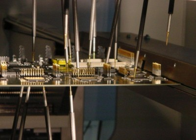 A flying probe test with top and bottom probes and programmable angles (http://acculogic.com/blog/production-testing-using-flying-probe-systems/)