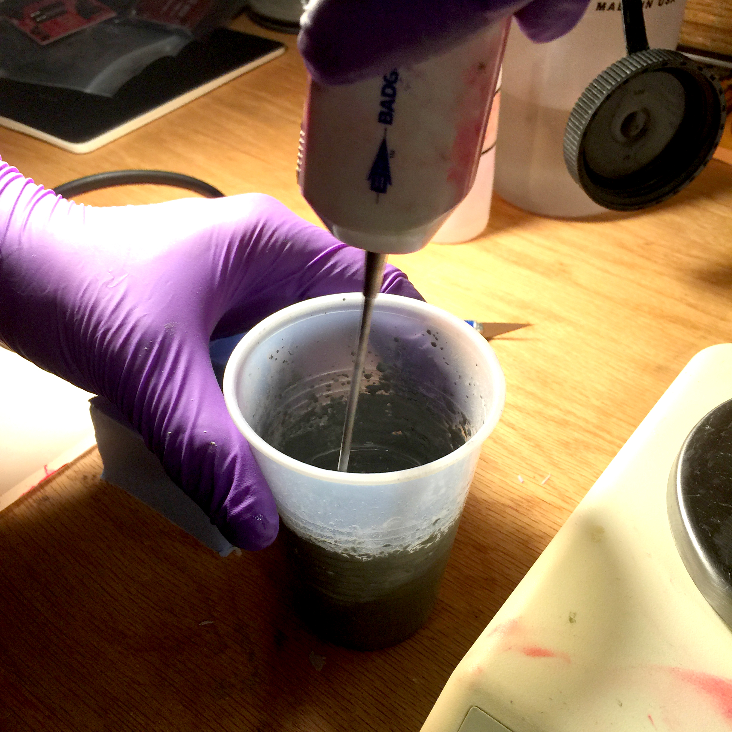Mixing the powdered metal and resin together before pouring.