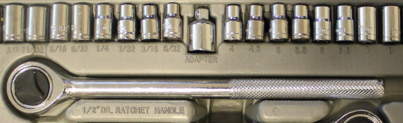 A socket wrench set in Imperial fractions on the left and metric on the right.