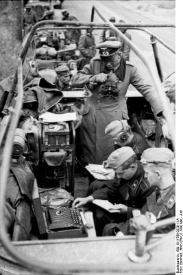 General Heinz Guderian overlooking the operation of an Enigma machine during the battle of France. Bundesarchiv, Bild 101I-769-0229-11A / Borchert, Erich (Eric) / CC-BY-SA 3.0, via Wikimedia Commons