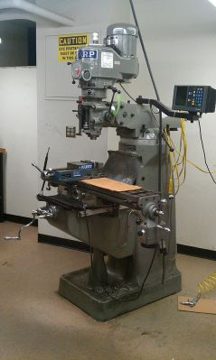 This is a vertical milling machine, with a head that rotates, tilts, and swivels (photo courtesy of Wikipedia)