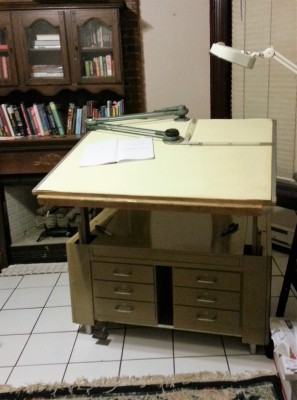 Nothing ties a room together in a small studio apartment like a 300lb drafting desk.