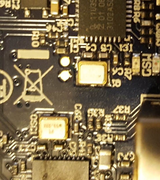 This PCB has two microcontrollers, and both have clocks as close as possible to the controller to minimize trace length.