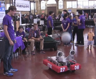 A Merge Conflict robot throwing a ball