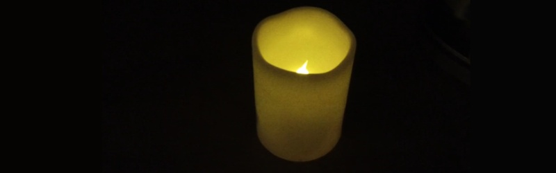 Candle with flicker led that you blow out