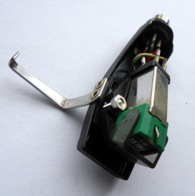 An Ortofon moving-magnet cartridge in its removable headshell.