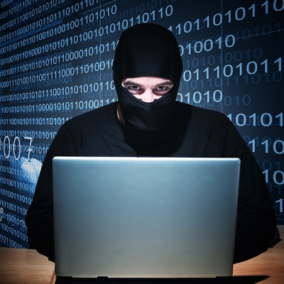 A hacker sporting a one-hole balaclava, STEALING YOUR DATA