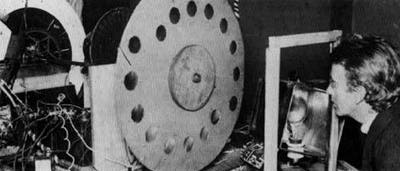 [Baird] with his invention, showing a large Nipkow disk. (Fair use).