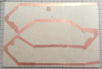 Copper strip on back of puzzle