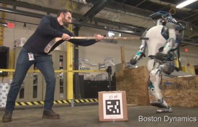 Atlas - Boston Dynamics robot being pushed