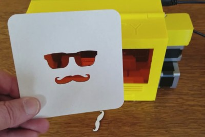 Glasses and mustache cut out of a pulpboard coaster