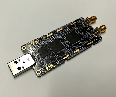 The LimeSDR Mini's chunky USB stick form factor.