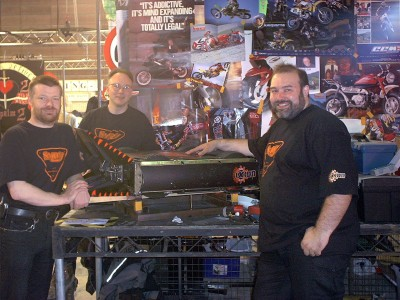 SMIDSY in the pits for series 5 of the UK Robot Wars TV show. From left to right: [Andy Pugh], [Robin Bennett], and [Mik Reed]. RIP [Mik].