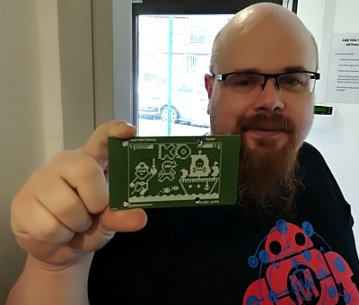 [Paul] showing off some of the Pimoroni attention to design detail. This artwork is hidden behind a display panel on the finished product.