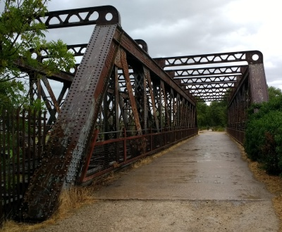 A handsome riveted railway bridge, over the River Avon near Stratford-upon-Avon, UK.