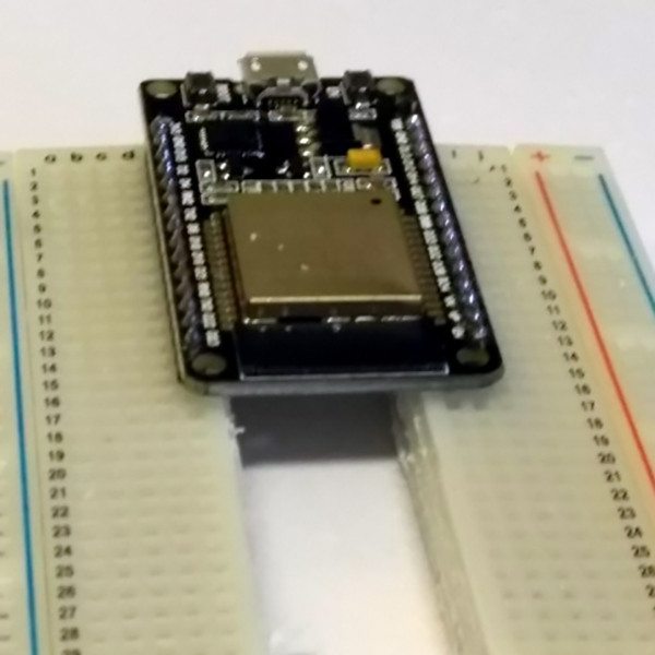 the solution to oversized dev boards a literal hack hackadaythe solution came to [luc] when he realized the center of every breadboard has no electrical connections, and was simply held together by a little piece of