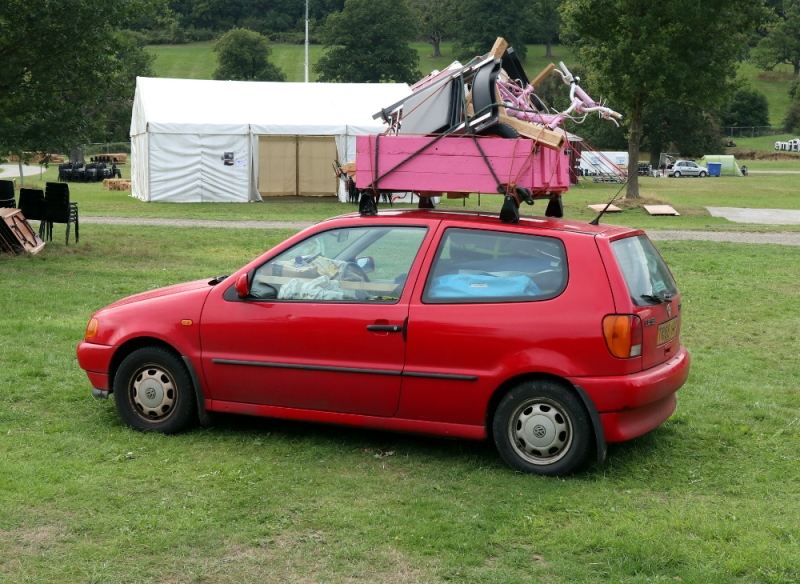 There is just enough space for the driver left in the car, with all the components of a hacker camp village loaded.