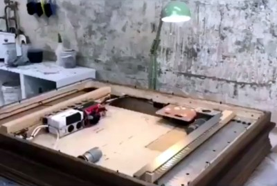 The interior of the Banksy shredder frame, taken from a frame of the video.