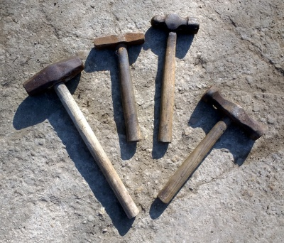 An array of hammers of different weights and types.