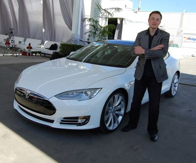 Elon Musk with a very shiny new Tesla. Maurizio Pesce [CC BY 2.0]