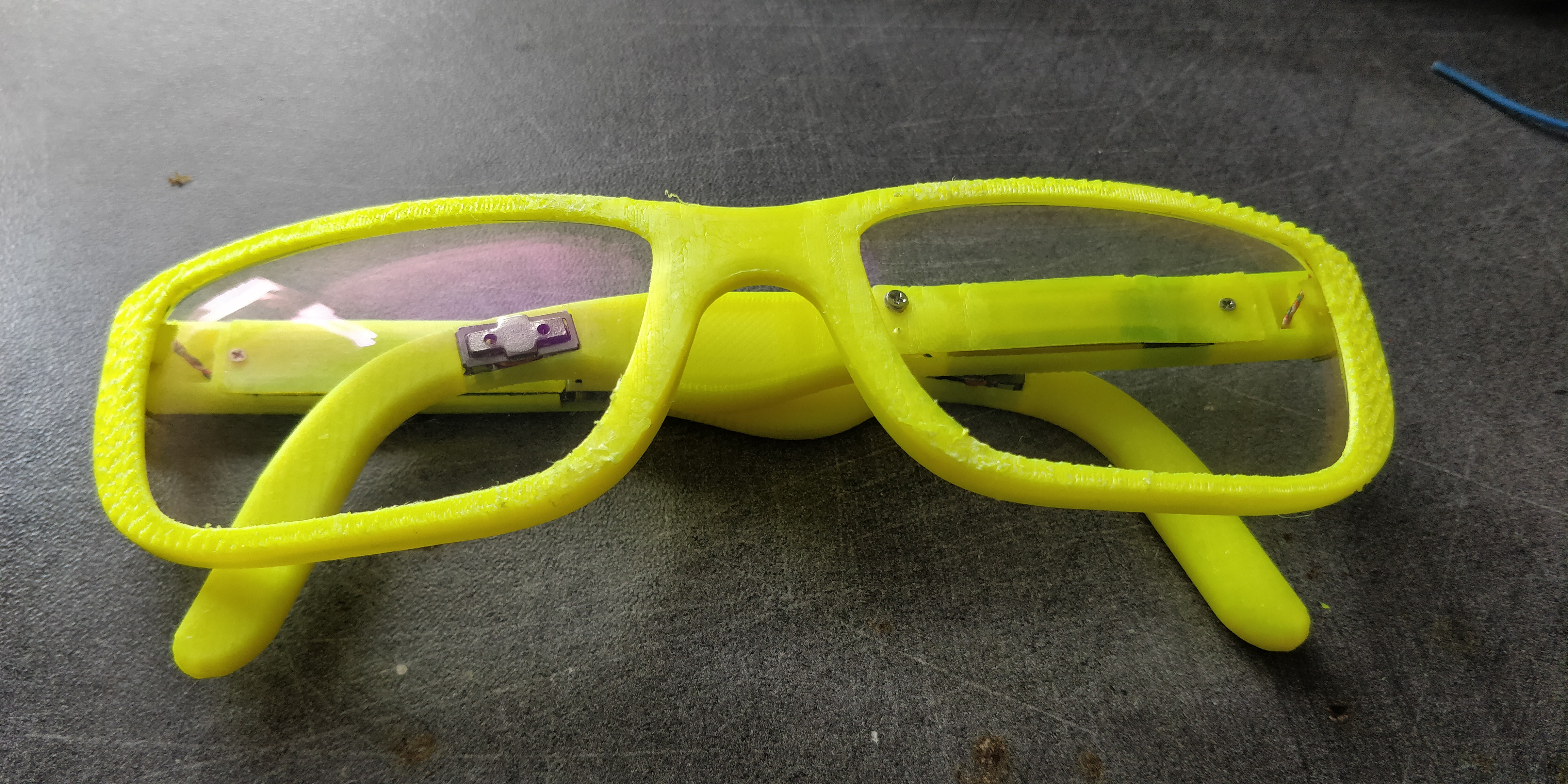 eee91c8c7798 The result is a surprisingly svelte set of specs that you might not  immediately think concealed some electronics. His choice of bright yellow  filament might ...