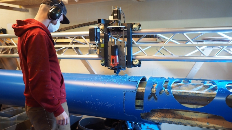 CNC Machine Rolls Up An Axis To Machine PVC Pipe | Hackaday