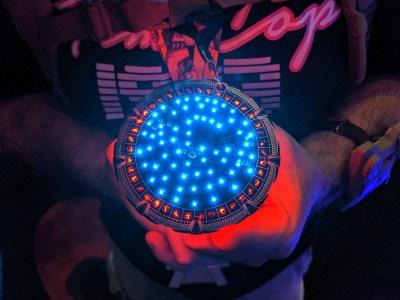 Stargate badge at DC27 - illuminated