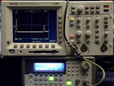 Time domain reflectometry demonstrated on the bench, with the original pulse on the left of the screen and its reflection on the right.