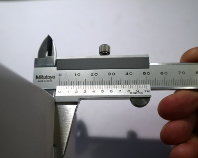 The business end of a Vernier caliper. The Vernier scale is on the lower part of the sliding jaw.
