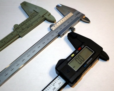 The selection of calipers under test. Left: sub £1 plastic Vernier caliper, centre: Mitutoyo 530-122 Vernier caliper, right: cheap digital caliper.